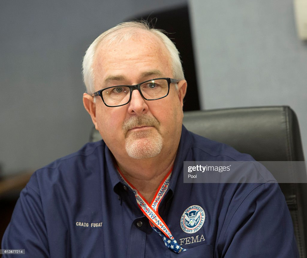 Administrator Craig Fugate listens as President Barack Obama makes a statement after receiving a briefing on Hurricane Matthew at the Federal Emergency Management Agency (FEMA) October 5, 2016 in Washington DC. The hurricane has pounded Jamaica and Haiti on its way north toward the U.S. coastline.