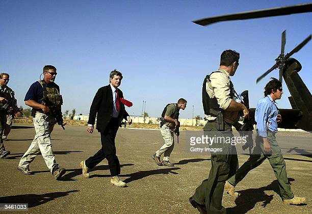 US administrator for Iraq L Paul Bremer leaves a palace of toppled leader Saddam Hussein after talks on the country's future with tribal leaders...