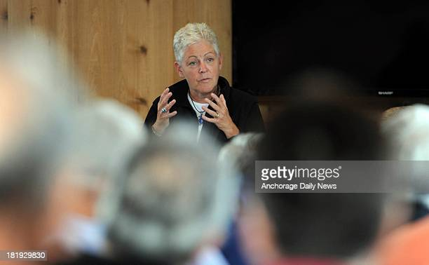 Administrator Gina McCarthy listens to people voice their concerns about the proposed Pebble Mine during a meeting in the Iliamna Lake Lodge on...