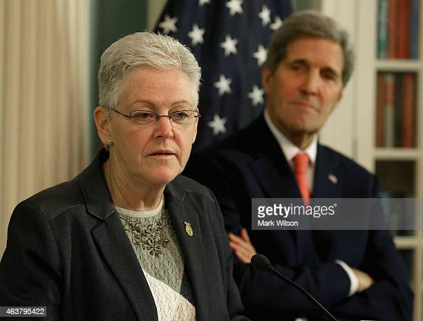 Administrator Gina McCarthy speaks while Secretary of State John Kerry stands nearby during a signing ceremony at the State Department February 18,...