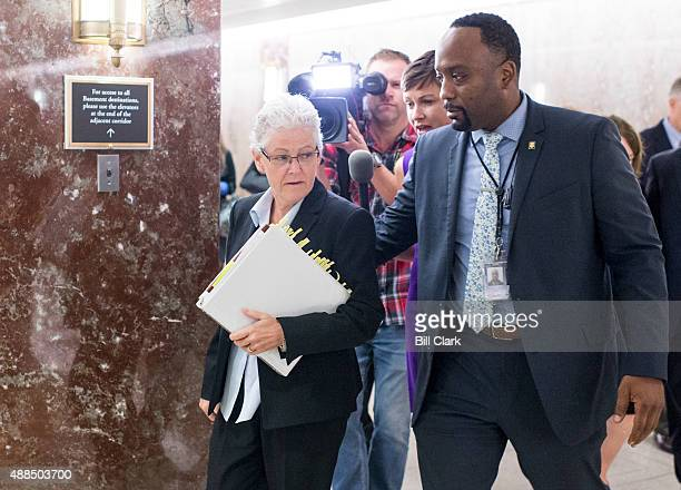 EPA administrator Gina McCarthy walks through the media after testifying on Wednesday Sept 16 during the Senate Environment and Public Works...