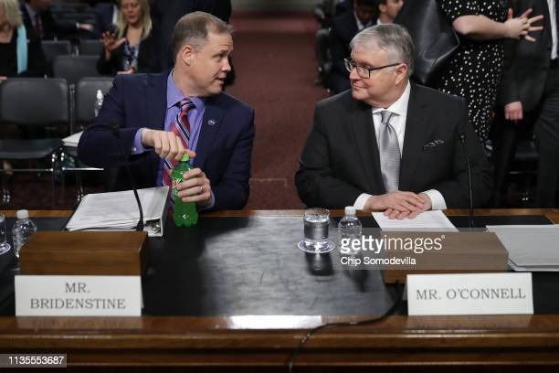 Administrator Jim Bridenstine and Office of Space Commerce Director Kevin O'Connell prepare to testify before the Senate Commerce Science and...