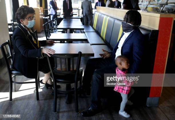 Administrator Jovita Carranza, left, meets with Jamaica Mi Hungry restaurant owner Ernie Campbell right during a tour in Boston to meet with PPP...