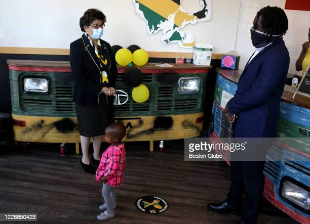 Administrator Jovita Carranza, left, meets with Jamaica Mi Hungry restaurant owner Ernie Campbell during a tour in Boston to meet with PPP...