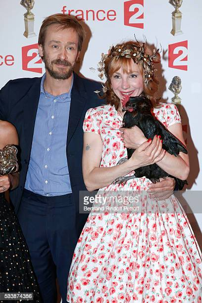 Administrator of the 'Comedie Francaise' Eric Ruf actress Julie Depardieu and her Chicken attend 'La 28eme Nuit des Molieres' on May 23 2016 in Paris...