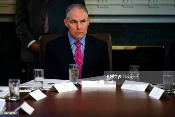 Administrator of the Environmental Protection Agency Scott Pruitt listens as President Donald Trump speaks about three hostages released from North...
