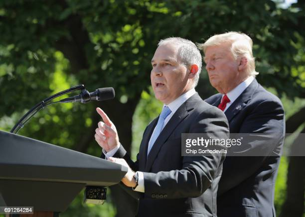 Administrator Scott Pruitt speaks after US President Donald Trump announced his decision to pull the United States out of the Paris climate agreement...