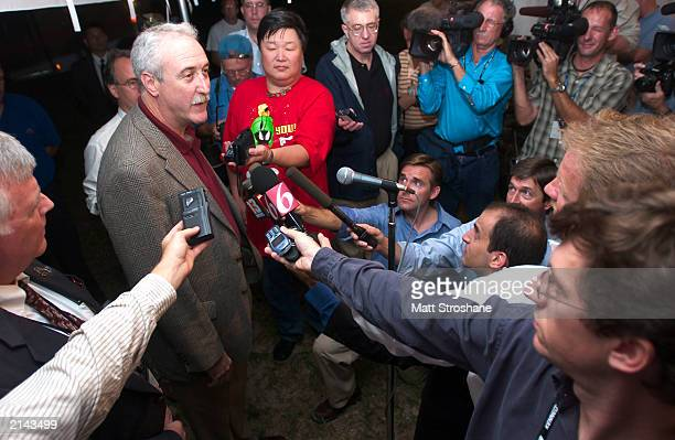 """Administrator Sean O'Keefe answers questions from the media after the successful launch of the second Mars Exploration Rover """"Opportunity,"""" lifted..."""