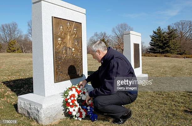 NASA administrator Sean O'Keefe lays a wreath at the Space Shuttle Challenger Memorial January 28 2003 at Arlington National Cemetery in Virginia The...