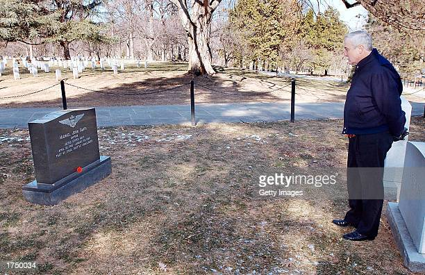 NASA administrator Sean O'Keefe visits the gravesite of Space Shuttle Challenger pilot Michael Smith January 28 2003 at Arlington National Cemetery...