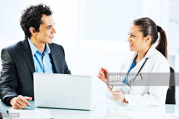 Administrator talking with a female doctor.