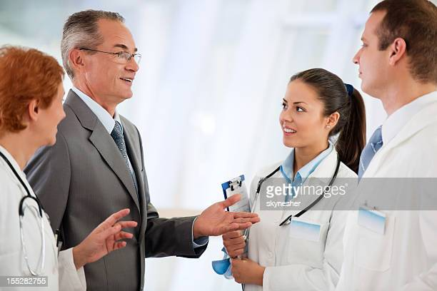 Administrator talking with Medical team at the Hospital