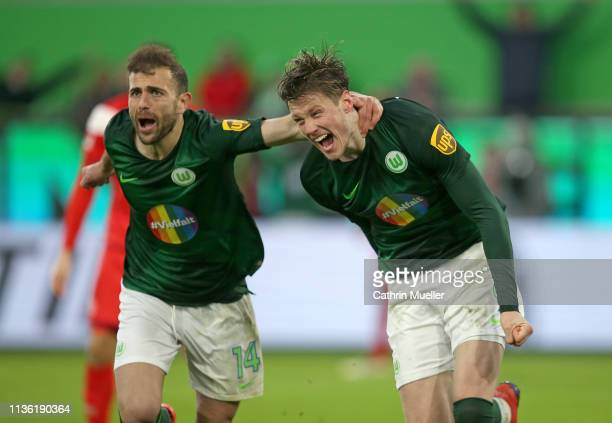 Admir Mehmedi and Wout Weghorst of Wolfsburg celebrate after scoring during the Bundesliga match between VfL Wolfsburg and Fortuna Duesseldorf at...