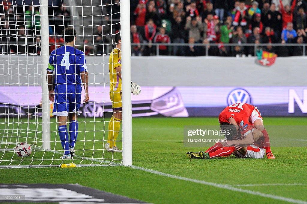 Admir Mehmedi celebrates with Josip Drmic of Switzerland scoring the third goal during the UEFA EURO 2016 qualifier between Switzerland and San Marino at AFG Arena on October 9, 2015 in St Gallen, Switzerland.