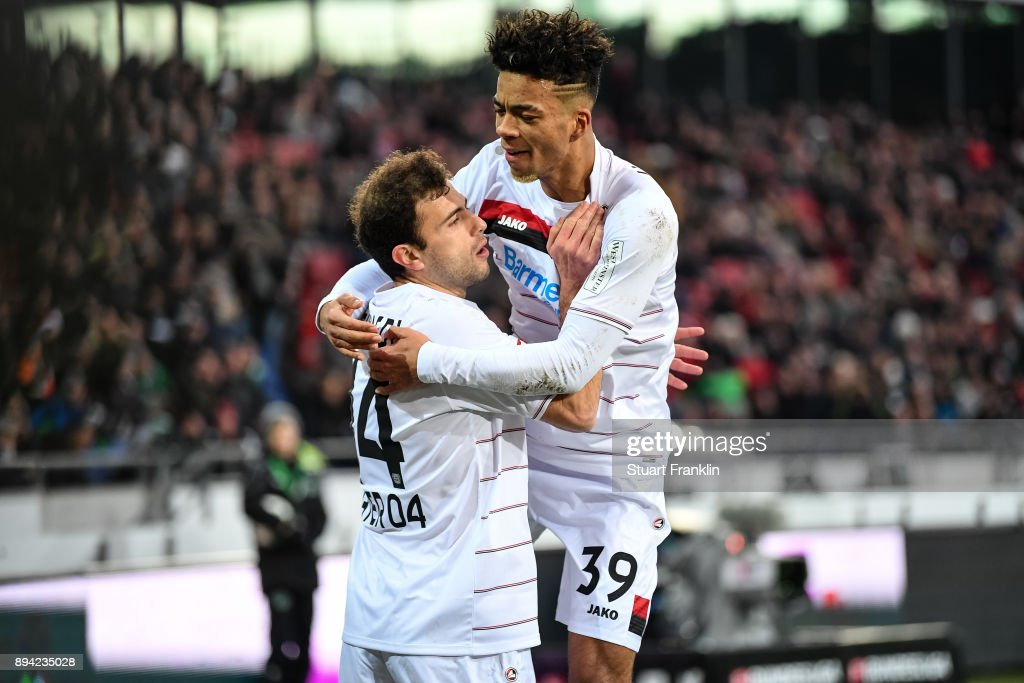 Admir Mehmedi #14 of Bayer Leverkusen celebrates with Benjamin Henrichs #39 of Bayer Leverkusen after scoring his team's equalizing goal to make it 2-2 during the Bundesliga match between Hannover 96 and Bayer 04 Leverkusen at HDI-Arena on December 17, 2017 in Hanover, Germany.
