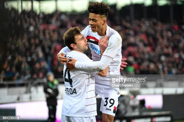 Admir Mehmedi of Bayer Leverkusen celebrates with Benjamin Henrichs of Bayer Leverkusen after scoring his team's equalizing goal to make it 22 during...