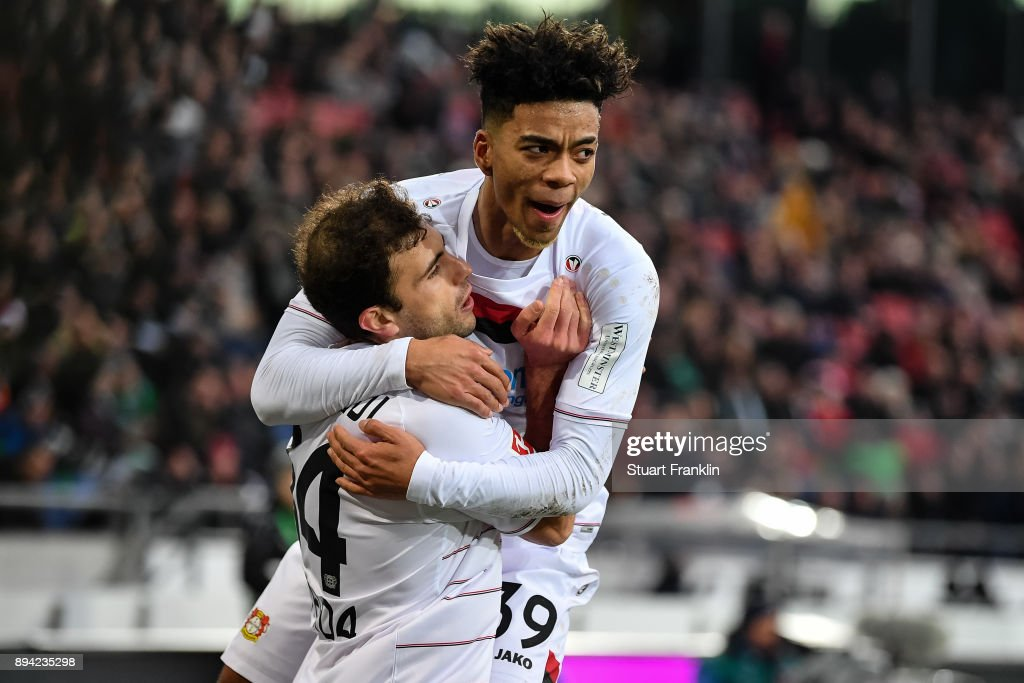 Admir Mehmedi #14 of Bayer Leverkusen celebrates with Benjamin Henrichs #39 (R) of Bayer Leverkusen after scoring his team's equalizing goal to make it 2-2 during the Bundesliga match between Hannover 96 and Bayer 04 Leverkusen at HDI-Arena on December 17, 2017 in Hanover, Germany.