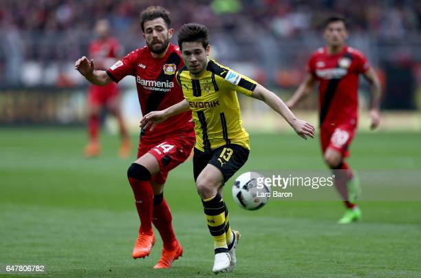 Admir Mehmedi of Bayer Leverkusen challenges Raphael Guerreiro of Dortmund during the Bundesliga match between Borussia Dortmund and Bayer 04...