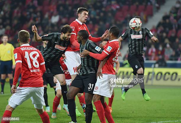 Admir Mehmedi of Freiburg scores his team's second goal past Stefan Bell of Mainz during the Bundesliga match between FSV Mainz 05 and SC Freiburg at...