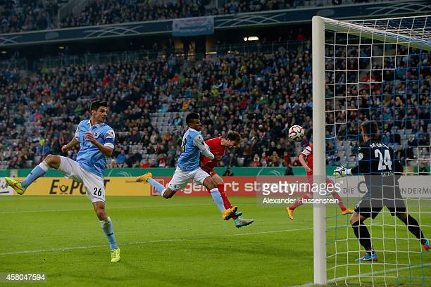 Admir Mehmedi of Freiburg scores the third team goal against Martin Angha of Muenchen and his keeper Stefan Ortega during the DFB Cup second round...