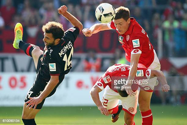 Admir Mehmedi of Leverkusen is challenged by Gaetan Bussmann and Pablo de Blasis of Mainz during the Bundesliga match between 1 FSV Mainz 05 and...