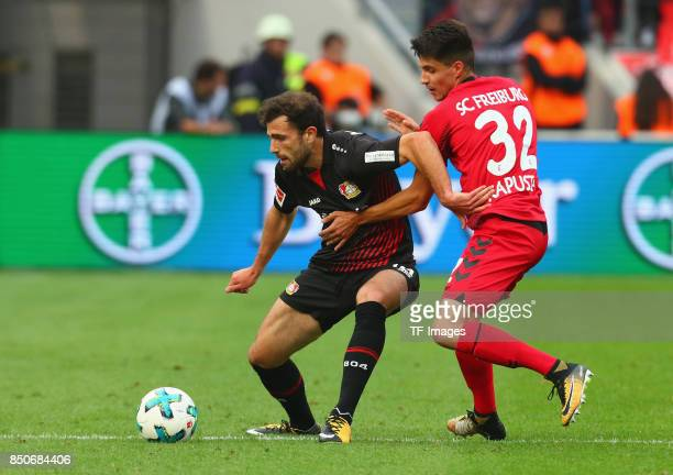 Admir Mehmedi of Leverkusenand Bartosz Kapustkabattle for the ball during the Bundesliga match between Bayer 04 Leverkusen and SC Freiburg at...