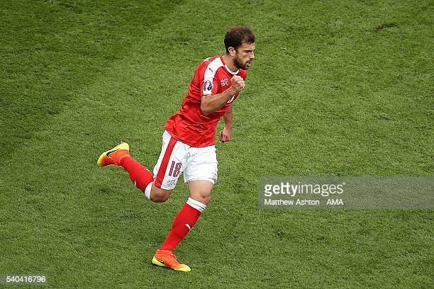Admir Mehmedi of Switzerland celebrates after scoring a goal to make the score 11 during the UEFA EURO 2016 Group A match between Romania and...