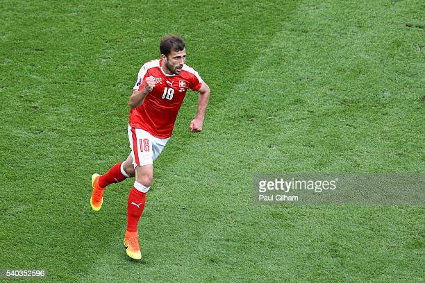 Admir Mehmedi of Switzerland celebrates after scoring his sides first goal during the UEFA EURO 2016 Group A match between Romania and Switzerland at...