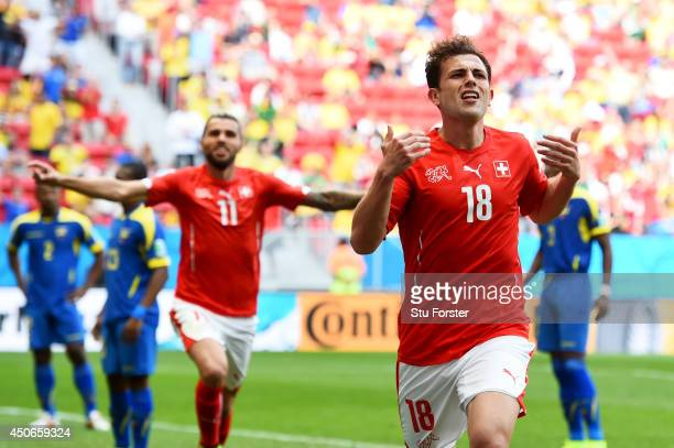 Admir Mehmedi of Switzerland celebrates scoring his team's first goal during the 2014 FIFA World Cup Brazil Group E match between Switzerland and...