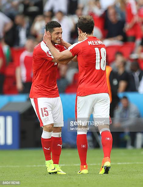 Admir Mehmedi of Switzerland celebrates scoring with Blerim Dzemaili of Switzerland during the UEFA EURO 2016 Group A match between Romania and...