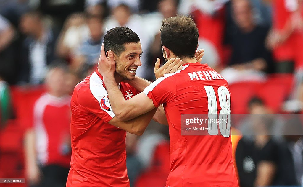 Admir Mehmedi of Switzerland celebrates scoring with Blerim Dzemaili of Switzerland during the UEFA EURO 2016 Group A match between Romania and Switzerland at Parc des Princes on June 15, 2016 in Paris, France.