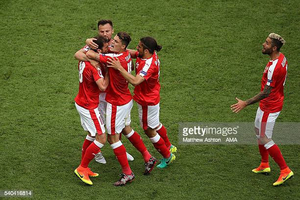 Admir Mehmedi of Switzerland celebrates with his team-mates after scoring a goal to make the score 1-1 during the UEFA EURO 2016 Group A match...
