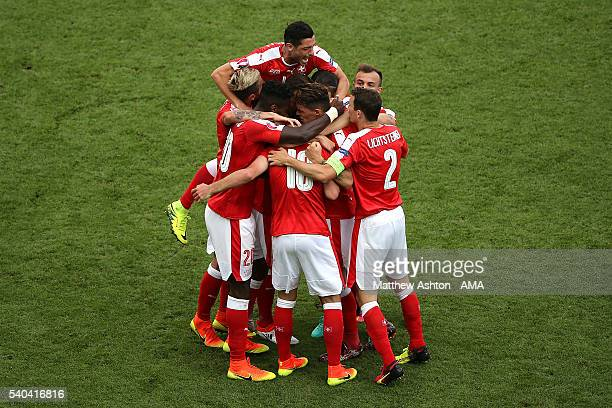 Admir Mehmedi of Switzerland celebrates with his teammates after scoring a goal to make the score 11 during the UEFA EURO 2016 Group A match between...
