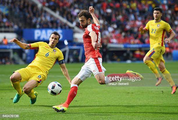 Admir Mehmedi of Switzerland is blocked by Vlad Chiriches of Romania during the UEFA EURO 2016 Group A match between Romania and Switzerland at Parc...