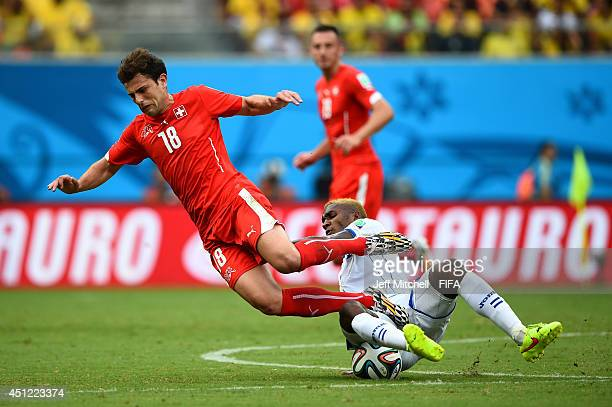 Admir Mehmedi of Switzerland is tackled by Brayan Beckeles of Honduras during the 2014 FIFA World Cup Brazil Group E match between Honduras and...