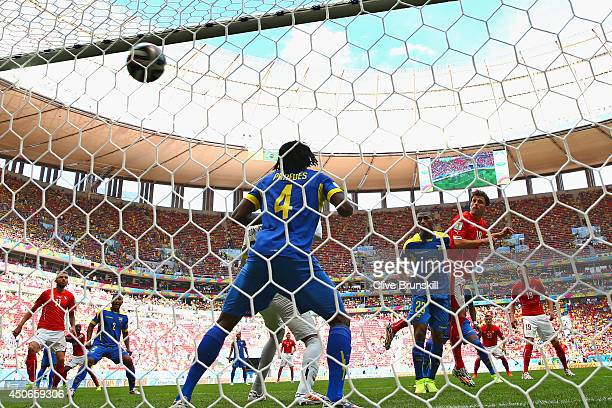 Admir Mehmedi of Switzerland scores his team's first goal on a header during the 2014 FIFA World Cup Brazil Group E match between Switzerland and...