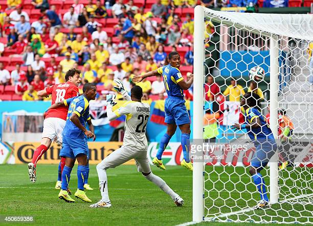 Admir Mehmedi of Switzerland scores his team's first goal on a header past goalkeeper Alexander Dominguez of Ecuador during the 2014 FIFA World Cup...