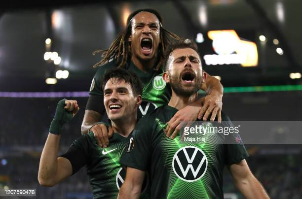 Admir Mehmedi of VfL Wolfsburg celebrates with Kevin Mbabu and Josip Brekalo of VfL Wolfsburg after scoring his team's second goal during the UEFA...