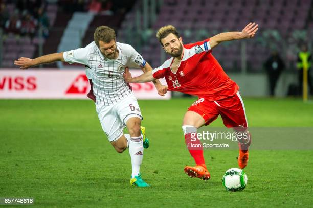 Admir Mehmedi vies with Vladislavs Gabovs during the World Cup Qualifiers group match between Switzerland and Latvia on March 25 at Stade de Geneva...