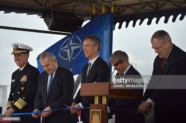 US Admiral and Commander of the US Naval Forces Europe Mark E Ferguson Romanian Foreign Minister Lazar Comanescu NATO Secretary General Jens...
