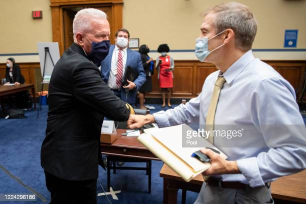 Admiral Brett P Giroir MD Assistant Secretary for Health left elbow bumps Rep Jim Jordan ROhio at the conclusion of a House Oversight and Reform...