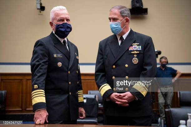 Admiral Brett P Giroir MD Assistant Secretary for Health left talks with Rear Adm John Polowczyk leader of the Supply Chain Stabilization Task Force...