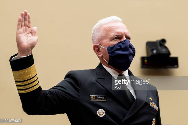 Admiral Brett P Giroir MD Assistant Secretary for Health swears in before testifying during a House Oversight and Reform Committee hearing on July 2...