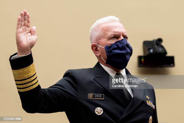 Admiral Brett P Giroir MD Assistant Secretary for Health swears in before testifying during a House Oversight and Reform Committee hearing on The...