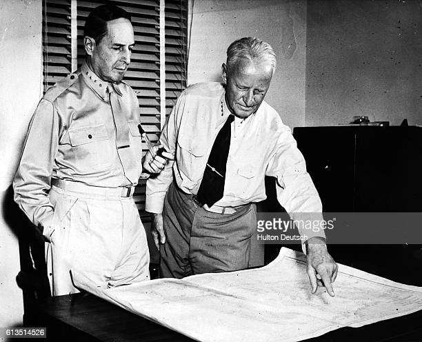 Admiral Chester Nimitz and General Douglas MacArthur map strategy for the war in the Pacific 1944