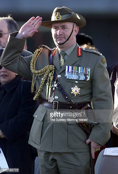 Admiral Chris Barrie hands over command of the Defence Forces to General Peter Cosgrove pictured who salutes him at the change of command ceremony in...