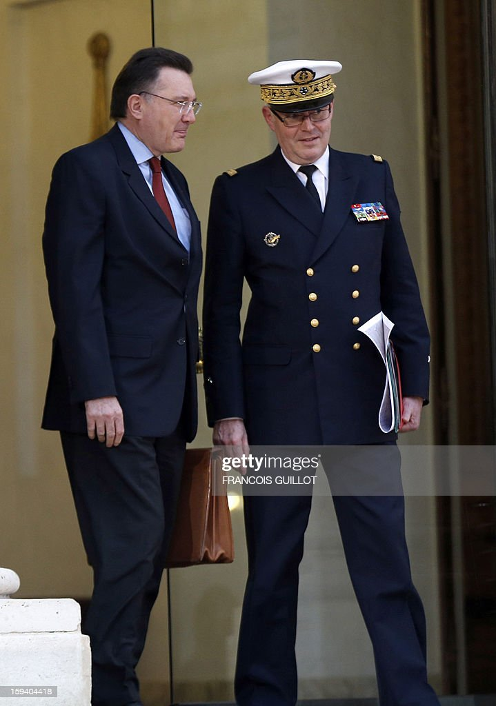 Admiral Edouard Guillaud (R), France's armies chief of staff, and Francis Delon (L), Secretary General of French Defence and National Security leave the Elysee presidential palace on January 13, 2013 in Paris after a defence council focused on the situation in Mali. French forces carried out airstrikes in Mali today for a third straight day and extended their bombing campaign to the northern strongholds of Islamist forces they are trying to drive out of the centre of the country.