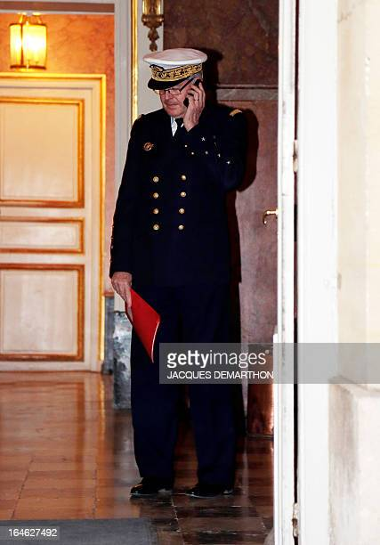 Admiral Edouard Guillaud French army chief of staff leaves after a meeting on the situation in Mali gathering ministers and members of parliament at...