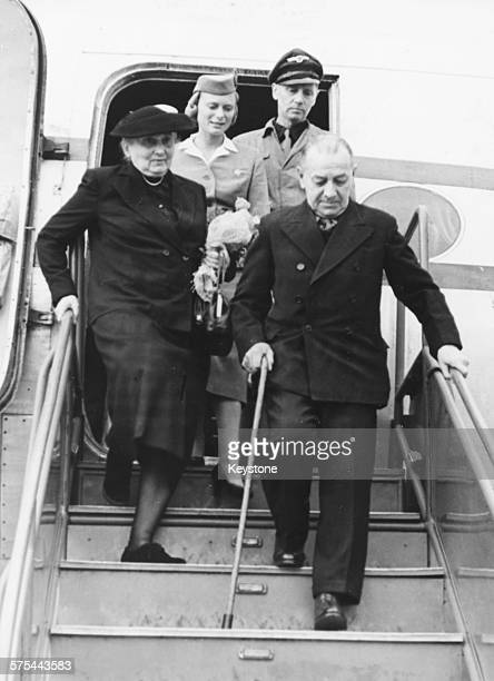 Admiral Erich Raeder walking down the steps of an airplane as he arrives in Hanover September 27th 1955