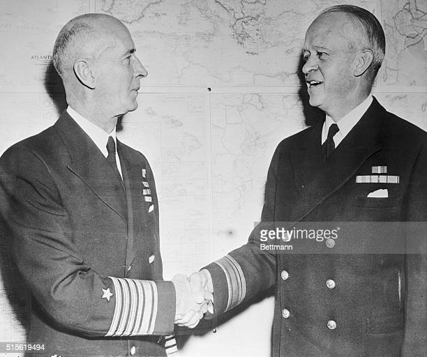 Admiral Ernest J King new CommanderinChief of the United States Fleet shakes hands with Rear Admiral Russell Willson Superintendent of the United...